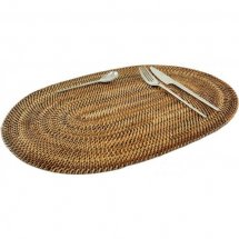Oval rattan placemat by Baolgi.