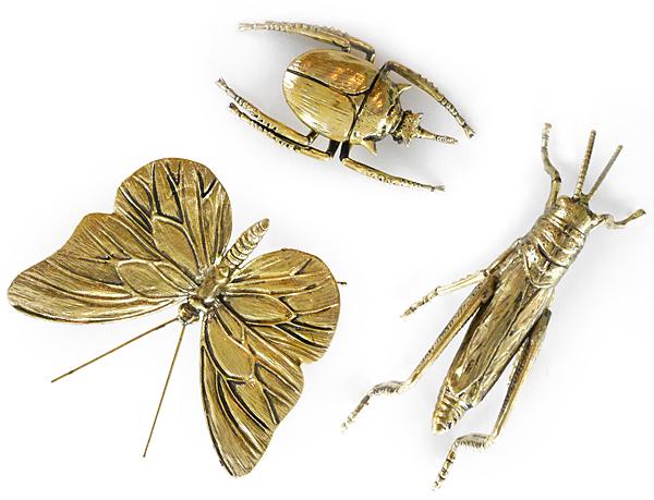 Insekter i mässing.